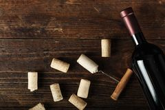 Bottle of red wine and cork royalty free stock photos