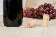 Bottle of red wine and corks Royalty Free Stock Photo