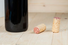 Bottle of red wine and corks Stock Image