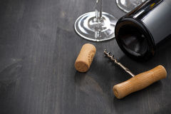 Bottle of red wine, corkscrew and empty glass Stock Photo