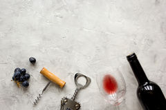 Bottle of red wine and corkscrew on stone background top view mockup Stock Images