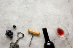 Bottle of red wine and corkscrew on stone background top view mockup Stock Photo