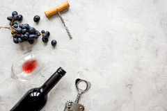Bottle of red wine and corkscrew on stone background top view mockup Royalty Free Stock Photos