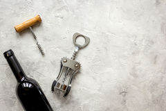 Bottle of red wine and corkscrew on stone background top view mockup Royalty Free Stock Photography