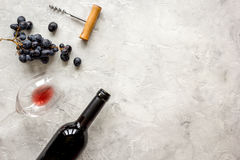 Bottle of red wine and corkscrew on stone background top view mockup Stock Photography