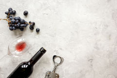 Bottle of red wine and corkscrew on stone background top view mockup Royalty Free Stock Photo