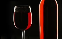 Bottle of red wine with filled wine glass Royalty Free Stock Photos