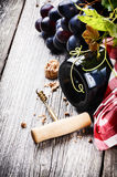 Bottle of red wine with fresh grape Royalty Free Stock Photo
