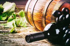 Bottle of red wine with fresh grape Royalty Free Stock Photos