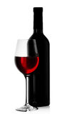 Bottle of red wine with a full glass Royalty Free Stock Images