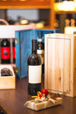 Bottle of red wine. Gift for holiday. Bottle of red wine in the wine room. Against the background of wooden boxes. Gift for holiday royalty free stock photography