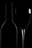 Bottle of red wine and glass Stock Photography