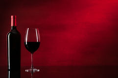 Bottle of red wine and glass. Closeup stock photography