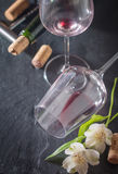 Bottle of red wine, glass, corks and corkscrew Stock Photos