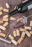 Bottle of red wine, glass, corks and corkscrew Royalty Free Stock Photos