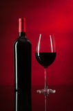 Bottle of red wine and glass. Bottle of red wine and glas. Closeup royalty free stock images