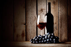Bottle of red wine with a glass and grapes Royalty Free Stock Photo