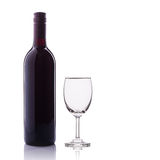 Bottle of red wine and glass. Studio shot isolated on white Stock Image