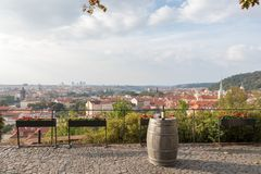 Bottle of red wine with glasses on a barrel in a Prague city, Czech Republic. Bottle of red wine on a barrel with sunrise in a Prague city, Czech Republic royalty free stock photography