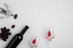 Bottle of red wine with glasses on white background top view mock-up