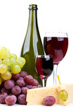 Bottle of red wine and grapes Royalty Free Stock Photography