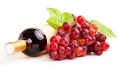 Bottle of red wine and grapes Royalty Free Stock Photos