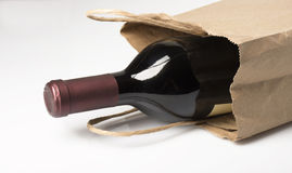 Bottle of Red Wine in Paper Bag Royalty Free Stock Image
