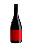 Bottle of red wine with red label on white background. Isolated Royalty Free Stock Photography