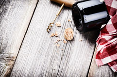 Bottle of red wine in rustic setting Stock Photo
