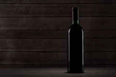 Bottle with red wine on the table. Bottle with red wine on the wooden table Royalty Free Stock Images