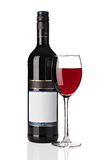 Bottle of red wine with wine glass Stock Images