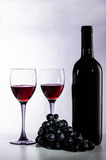 Bottle of red wine,  wine glasses and grapes Royalty Free Stock Photography