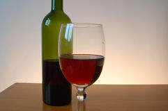Bottle of red wine with wineglass. Isolated Royalty Free Stock Image