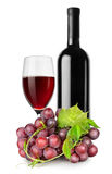 Bottle of red wine, wineglass and grapes. Isolated on a white background stock photo