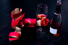 Bottle of red wine on the wooden floor Stock Image