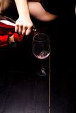 Bottle of red wine on the wooden floor Stock Images