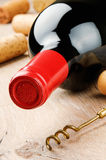 Bottle of red wine on wooden table Stock Photos