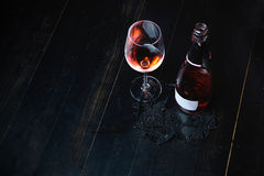 Bottle of red wine on the wooden table Stock Image