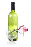 Bottle and roses Royalty Free Stock Photography