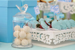 Bottle with round coconut candies. Decorated in wedding style with colored custard, bows and frosting Royalty Free Stock Image
