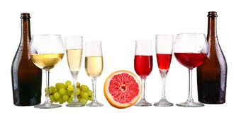 Bottle, a row of white wine glasses with wine and grapes isolate. D on white background stock photography