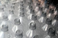 Bottle rows stacked wrapped in plastic Stock Image