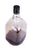 Bottle of Rum. A bottle of dark rum, on white studio background Stock Photos
