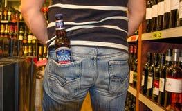 Bottle Samuel Adams Boston Lager in back pocket Stock Image