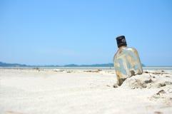 Bottle on a sand beach Stock Photos