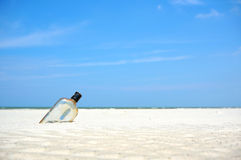 Bottle on a sand beach Stock Image