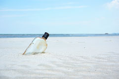 Bottle on a sand beach Stock Image