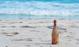 Bottle in the sand Royalty Free Stock Images