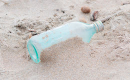 Bottle in the sand. Empty glass bottle in the sand Royalty Free Stock Photos