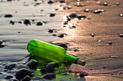 Bottle at sea Stock Photography
